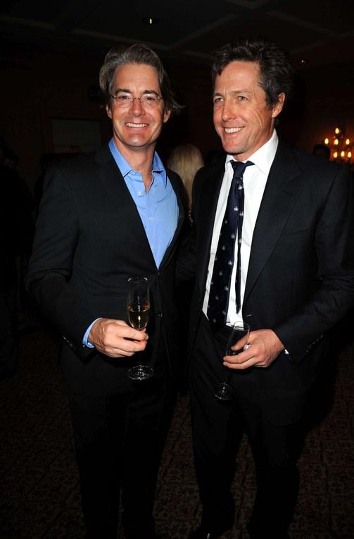 Hugh Grant y Kyle Maclachlan, octubre 2009