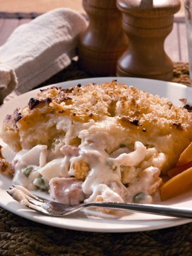 Creamy fish pie with cheese and potato topping