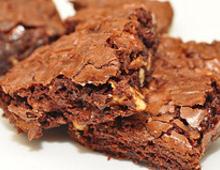 Vegan Chocolate fudge brownie with raspberry sauce