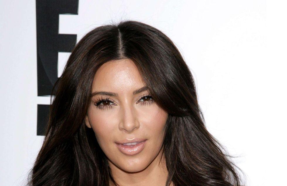 Kim Kardashian : Elle met la main aux fesses de Kanye West en public