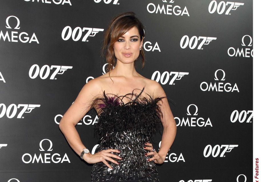 Bérénice Marlohe : Glamour en robe-bustier avec son décolleté plumé (Photos)