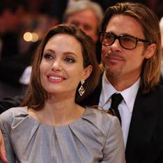 Angelina Jolie's gold ring sparks rumours she's already married Brad Pitt