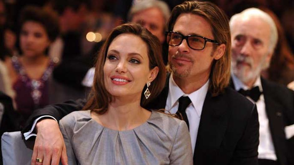 Angelina Jolie's gold ring sparks rumours she's already married Brad Pitt