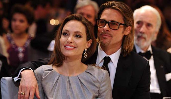 Brad Pitt and Angelina Jolie looking loved-up