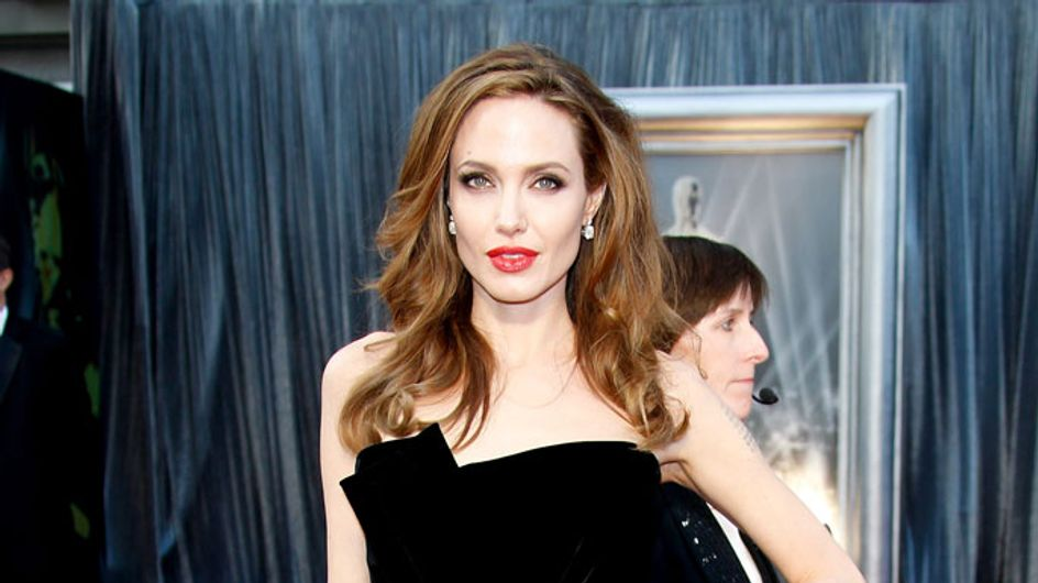 Angelina Jolie topless horse photo set to sell for £30,000