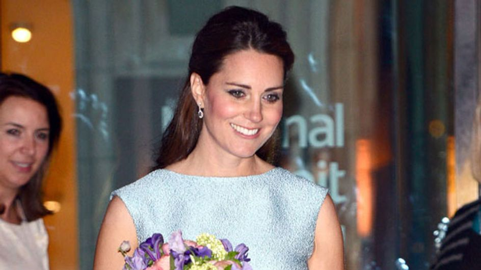 "Pregnant Kate Middleton is defiant as ""two people are charged"" over topless photo scandal"