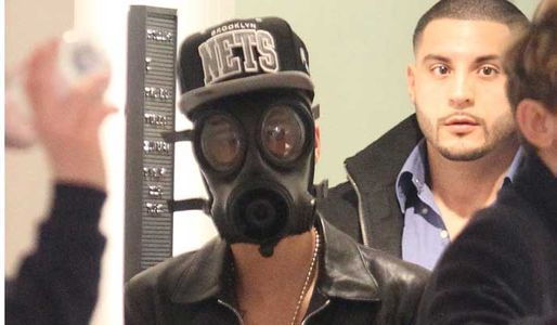 Justin Bieber in a gas mask in London