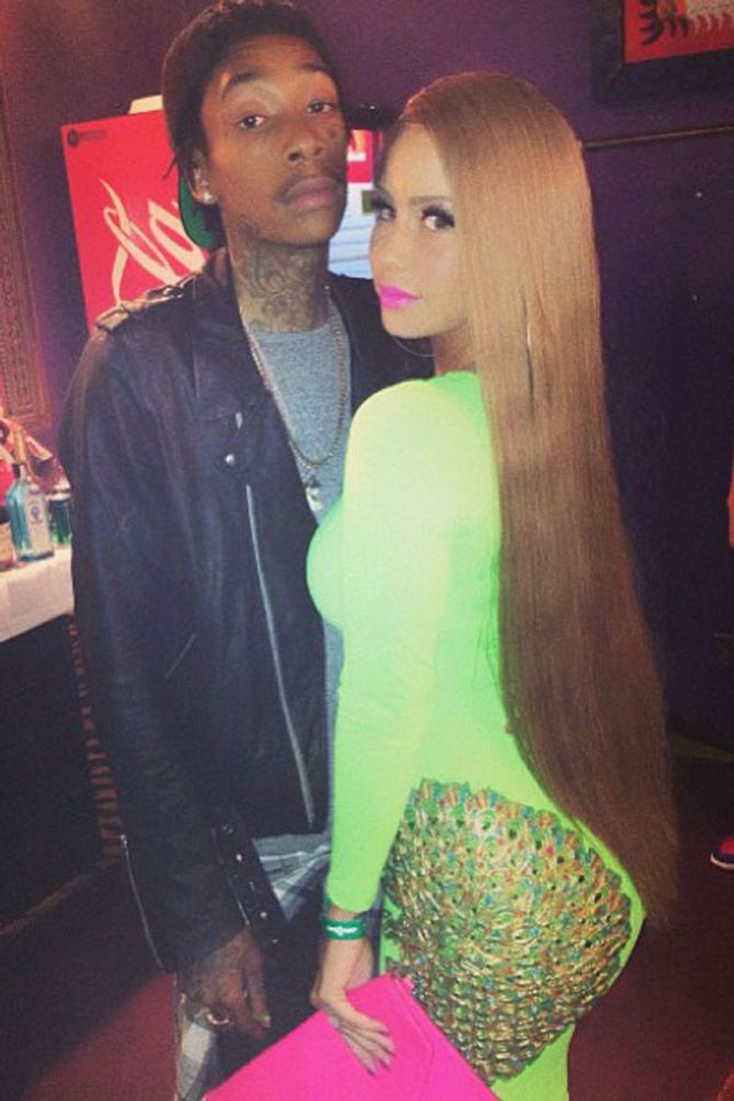 Amber Rose hair: Model trades in her iconic buzz cut for new tumbling hairstyle