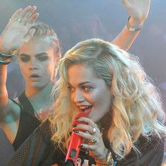 Cara Delevingne steals the mic from Rita Ora as they dirty dance at party