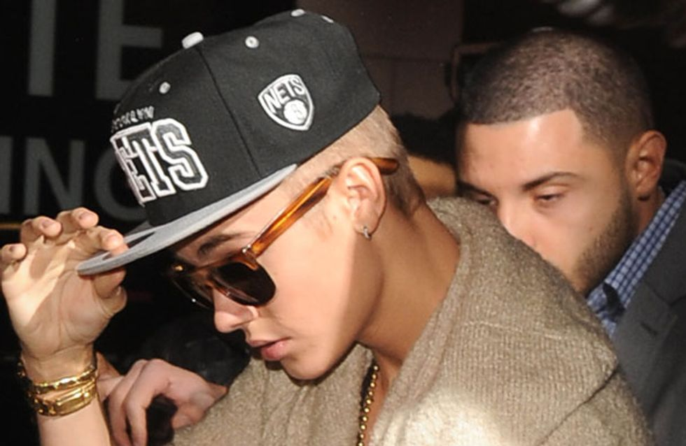 Justin Bieber denies spitting on fans as he's cleared of hit and run