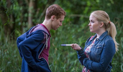Abi shows Jay the results of her pregnancy test