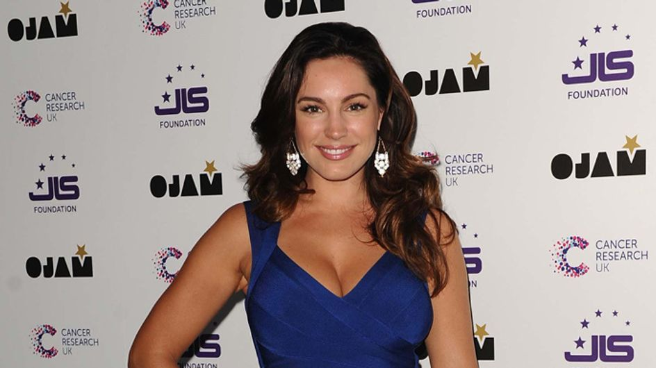 WATCH: Kelly Brook strips down to her underwear for risqué shoot