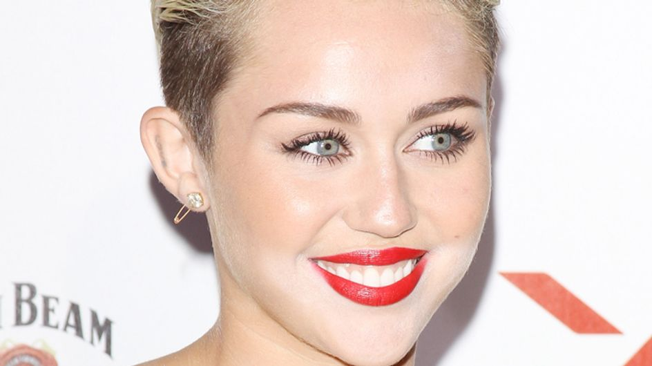 Underaged Miley Cyrus caught boozing and snogging Benji Madden