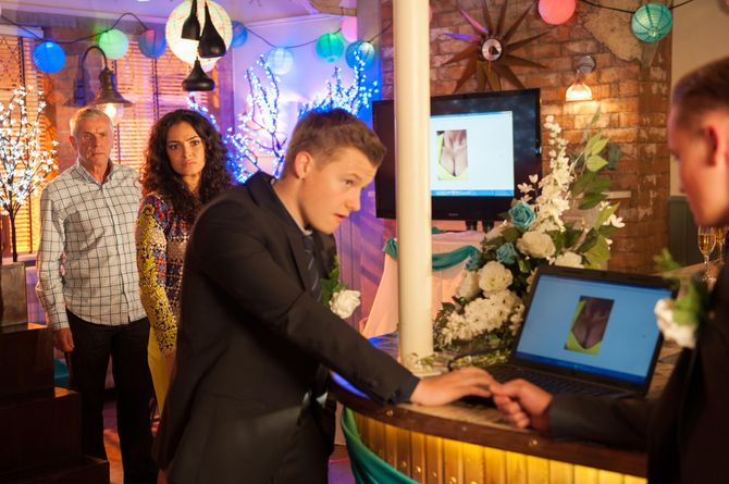 Robbie tampers with the wedding slide show