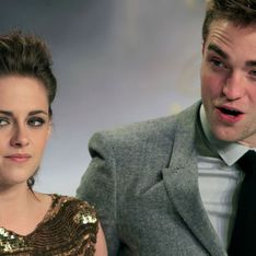 Robert Pattinson heads to London for Christmas as Kristen Stewart parties in Hollywood