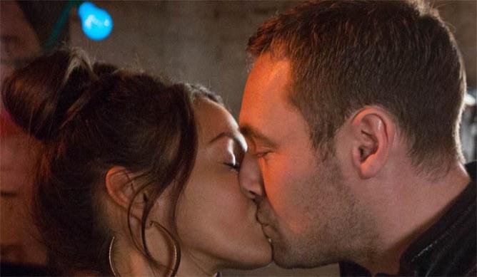 Tina and Rob kiss