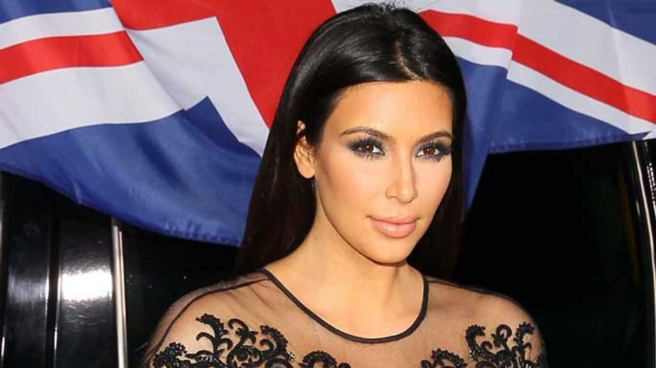 Kim Kardashian invites a fan to join her in the VIP section of Kanye West's concert
