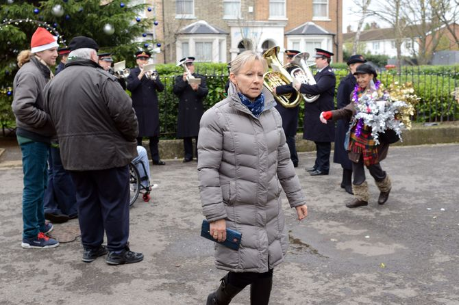 A distracted Carol wanders through the Square