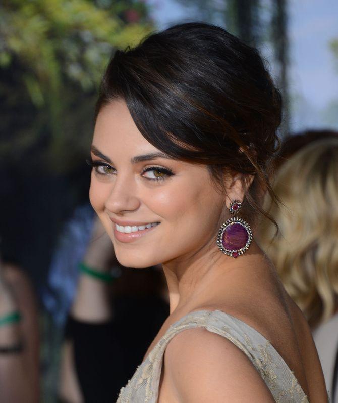 Mila Kunis en 2013