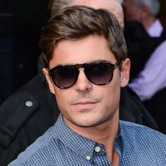 Zac Efron shows off six month sobriety chip