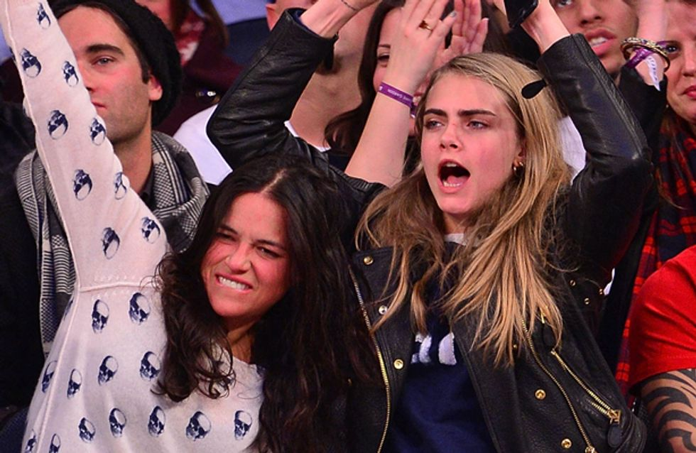 Cara Delevingne and Michelle Rodriguez cuddle up and kiss at New York Knicks game
