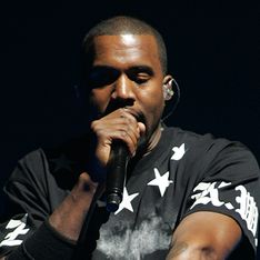 Kanye West has apparently attacked an 18-year-old over racial slurs