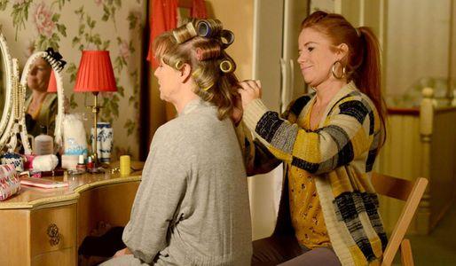 Bianca does Carol's hair