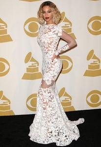 Beyonce shows off a tiny waist and uber-trim looking figure on the Grammys Red Carpet.