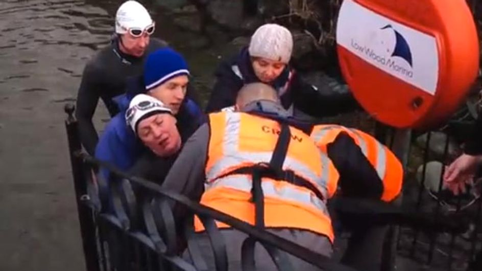 An exhausted Davina McCall is dragged out of lake during Sport Relief challenge