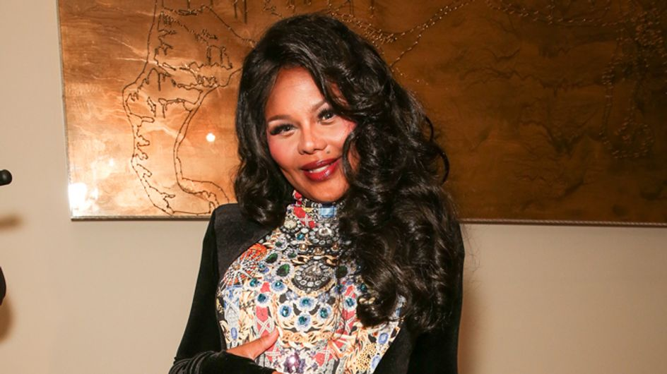 Lil' Kim is welcoming a lil' one of her own! Rapper shows off baby bump at NYFW