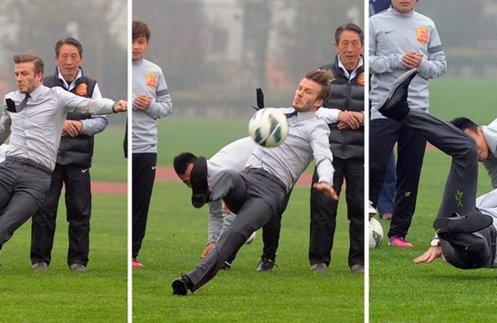 Beckham se cae y muestra el torso en su visita a China