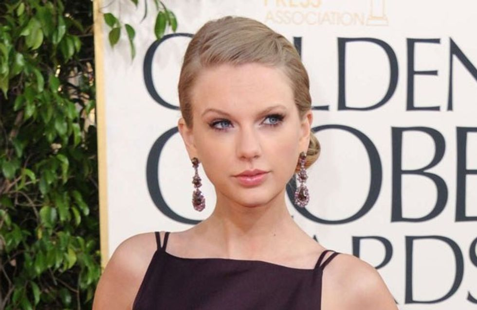 Taylor Swift accidentally flashes her boob in revealing Golden Globes dress