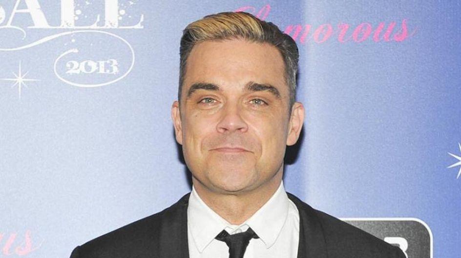 Robbie Williams legt sich für seinen Sohn unter die Nadel