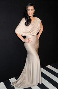 Kim Kardashian en Victoria Beckham en 2011