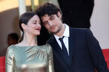 Marion Cotillard et Louis Garrel venus présenter le film Mal de Pierre de Nicole Garcia dimanche 15 mai 2016 au Festival de Cannes