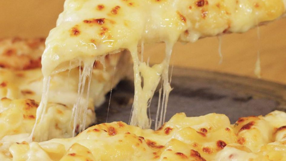 This UK Pizza Chain Is Selling A Mac And Cheese Stuffed Crust & We're Not Worthy