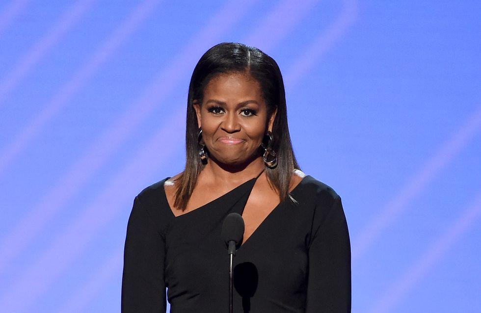 Michelle Obama, un retour remarqué dans une robe noire moulante très chic (Photos)