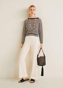 Come abbinare i pantaloni bianchi a zampa