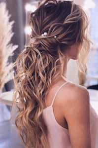 acconciatura sposa capelli lunghi: la coda